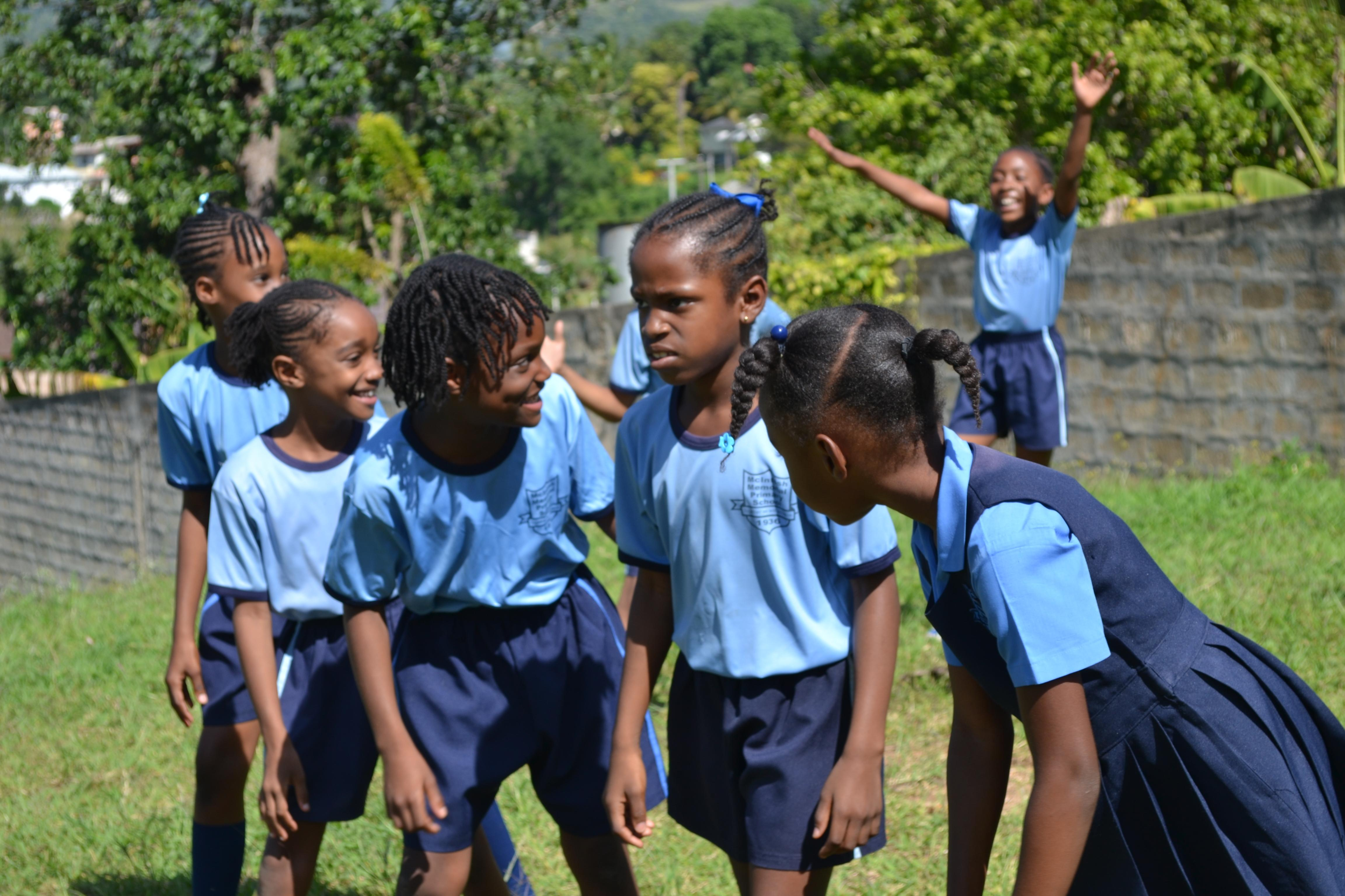 A physical education teacher gives lessons while volunteering as a sports coach in schools in Jamaica